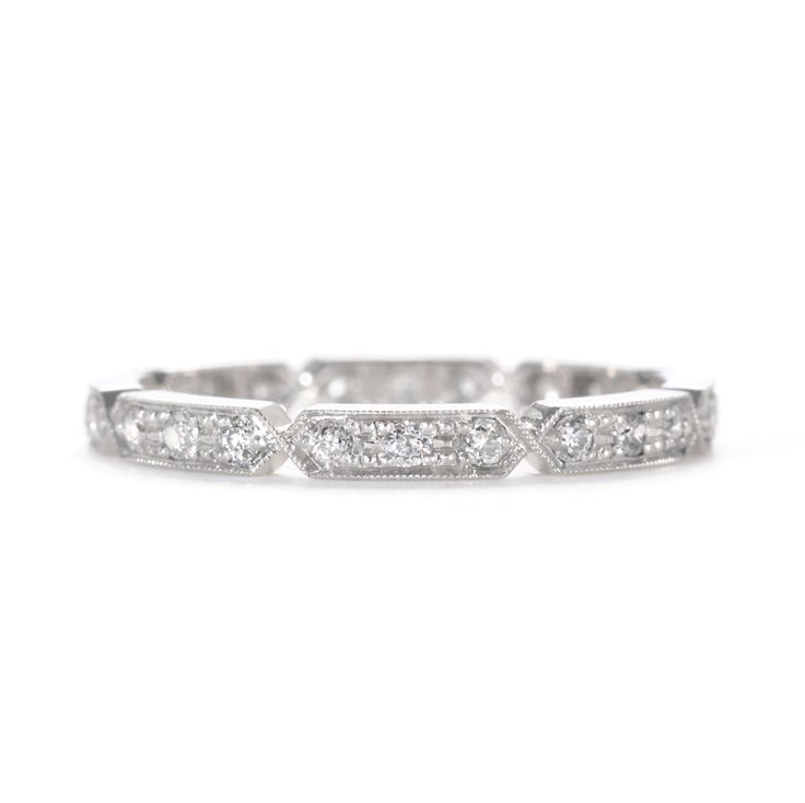Geometric and vintage inspired, this diamond wedding band echos the Art Deco era and is finished with fine milgrain borders.  at Greenwich Jewelers