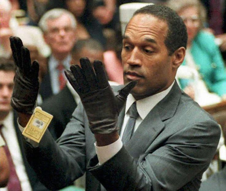June 1995 — O.J. Simpson trials. Former professional football player and actor O.J. Simpson tries on a new pair of Aris extra-large gloves that prosecutors had him put on during his double-murder trial in Los Angeles, California.
