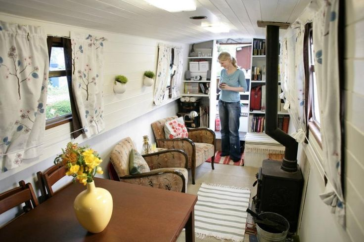 Some great ideas for a tiny house from this long narrow house boat in London.