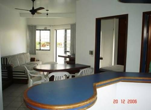 Residencial Agua Marinha Canasvieiras Featuring air conditioning, Residencial Agua Marinha offers accommodation in Canasvieiras. Florianópolis is 20 km from the property.  All units feature a TV. All units have a kitchen equipped with a fridge and stovetop.