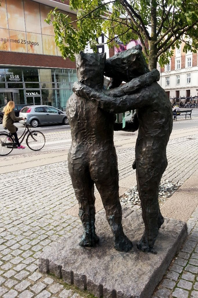 Statues in Copenhagen observes the street life