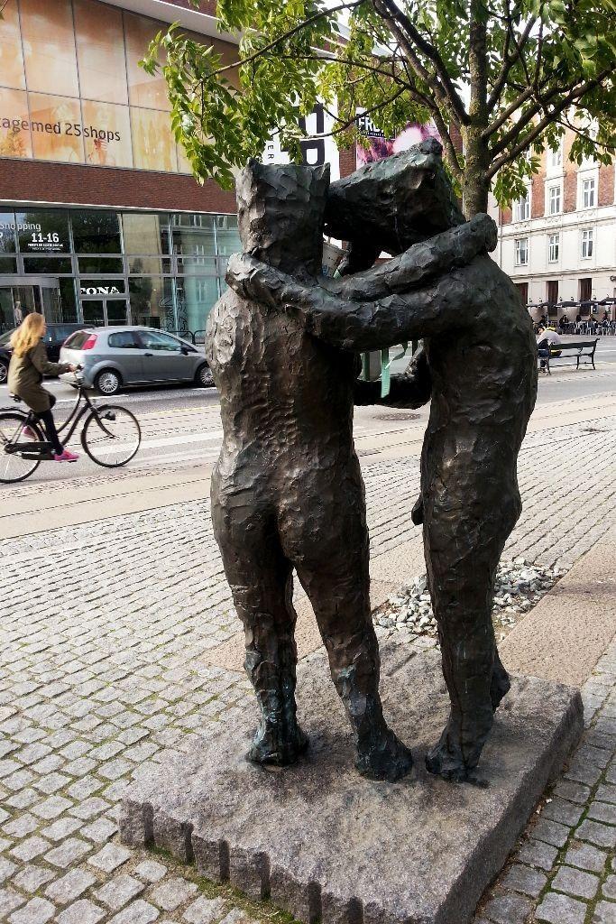 Statues in Copenhagen observes the street life