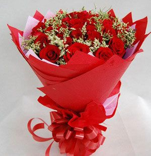 red roses with greens, hot red package and beautiful bowknot.