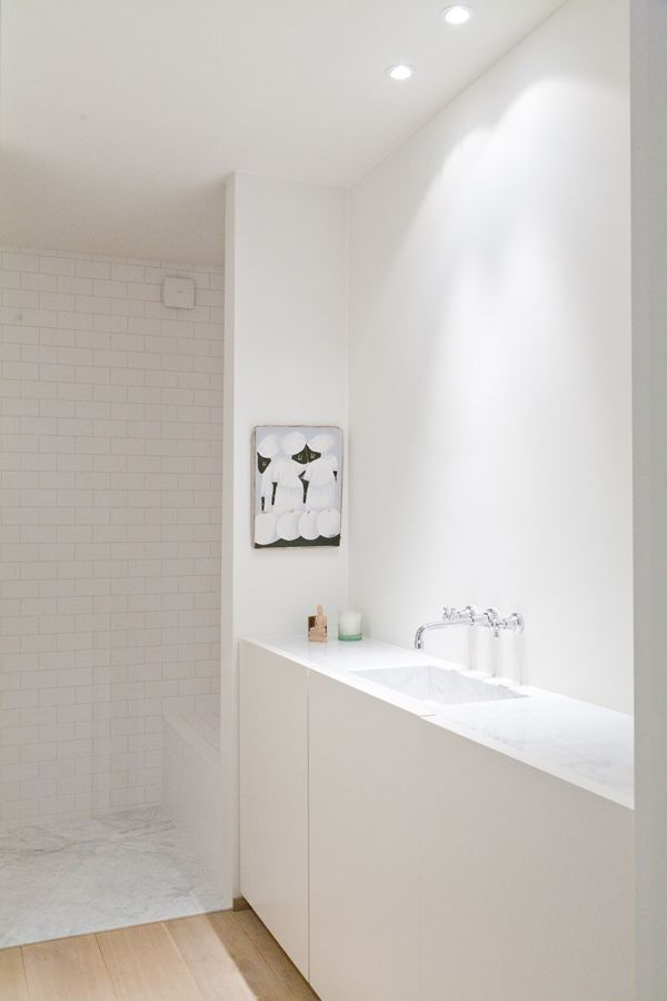 Annemarie van Riet, Belgium. Light timber floor, marble, white tiles, white plaster