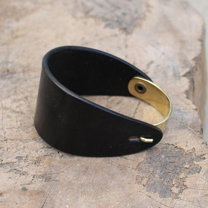 Fortitude bracelet - a genuine leather wide cuff with curved metal hook closure. Made with chocolate leather and polished antique brass. $58