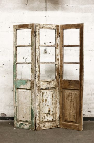 reclaimed old doors turned vintage folding screen... Maybe put canvas or burlap in the windows?                                                                                                                                                      More