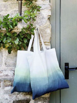 Reusable shopping bags are now a necessity. Here's a simple idea; order pre-made canvas bags (£1 each) and dip-dye