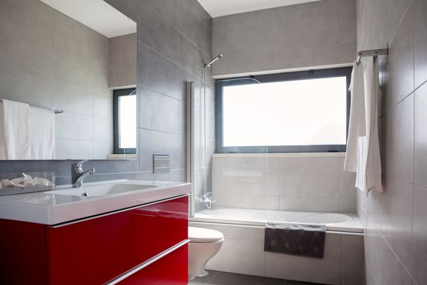 Carina Villas Portugal - Modern bathroom, with luxury bath tub / shower, with a toilet and sink.