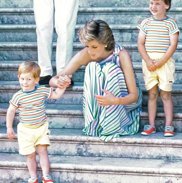 Princess Diana holds the hand of Prince Harry as Prince William looks on during a family trip to Majorca in Spain in 1986