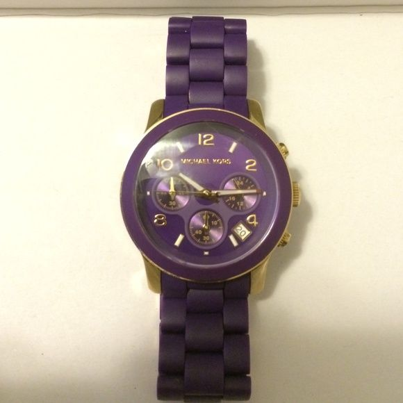 Michael Kors Purple and Gold Silicon Runway Watch Beautiful twist on the classic MK runway watch. MK5324 Michael Kors purple silicon wrapped runway watch. Chronograph. Only worn once, sticker still on the back of the case. Does have a tiny scratch on the bottom left hand side of the dial that's hard to see. Gold accents. New battery needed. MICHAEL Michael Kors Accessories Watches