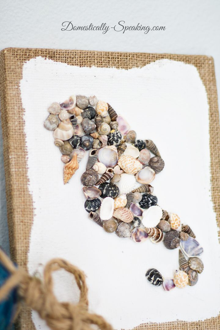 DIY Seashell Seahorse Art - a fun project using a burlap canvas and mini seashells to create a seahorse.  Cute nautical art!