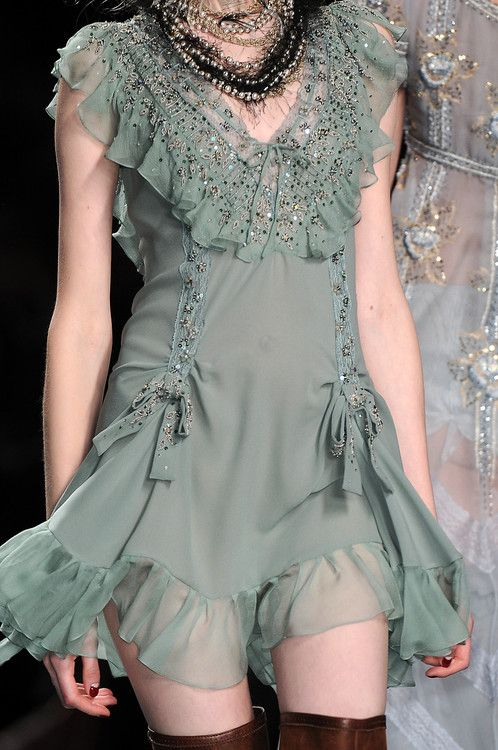 I love this little dress with the thigh-high boots!    Christian Dior - Fall 2010