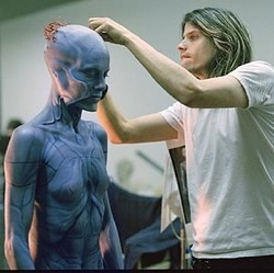 Long before Adam Jones was Tool's notorious lone axeman, he was a makeup artist/set designer for films like Jurassic Park and Terminator 2. Though he left that budding career in feature filmmaking behind after joining Maynard James Keenan and Danny Carey in Tool, Jones went on to showcase his sculptures, animation, and direction in the band's videos.