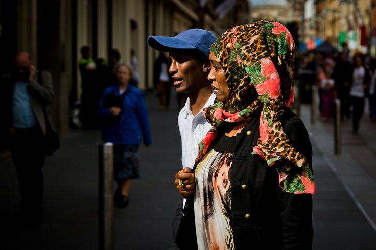 https://flic.kr/p/q1shEW | Big Red Flowers | © Leanne Boulton, All Rights Reserved Street candid taken in Glasgow, Scotland. The striking pattern of this woman's headscarf caught my eye and the lighting was perfect for a split-second shot to get them in frame as they walked by.
