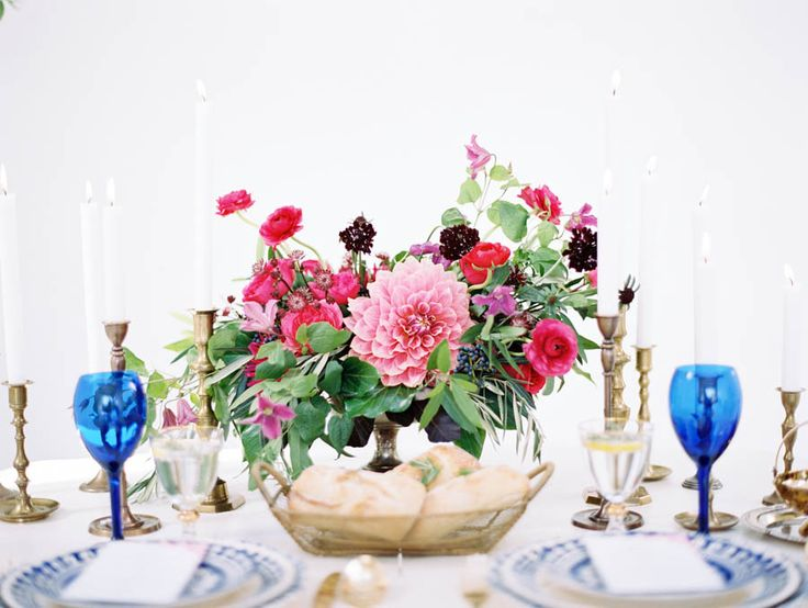 Destination wedding, Santorini, centerpiece, florals, blue wine glasses, candles, bread
