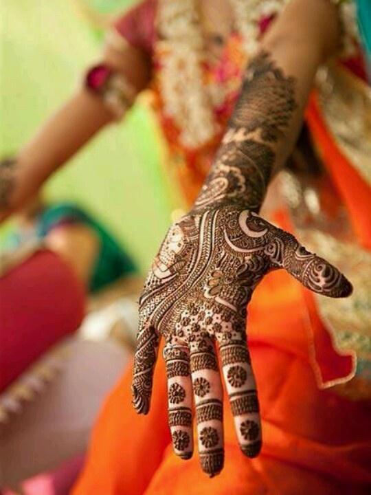 Mehendi Designs - Bridal Mehendi with face design on the hand | WedMeGood #wedmegood #mehendi #wedding