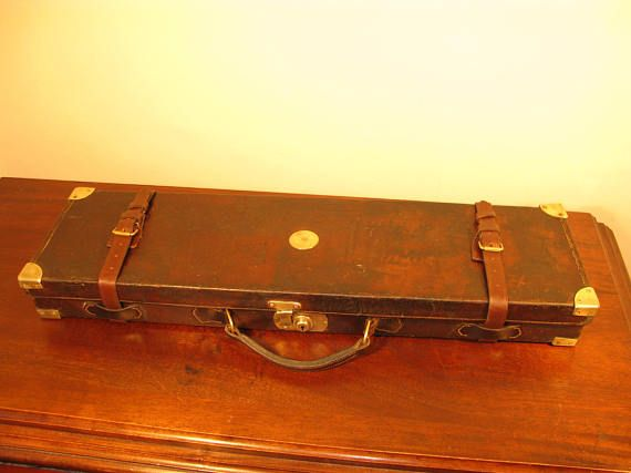 Extremely Nice Antique Edwardian Period High Quality Saddle Leather Shotgun Motor Case By Stephen Grant & Joseph Lang Gun & Rifle Makers 7 Bury Street St Jamess London S.W.1 England Circa 1925  A extremely nice early Edwardian shotgun or double rifle motor case.  Of oak construction, covered with heavy saddle leather for field use with stitched leather seams and brass protective corners. The brass catch is fully operational without key to lock, and leather retaining straps for added s...