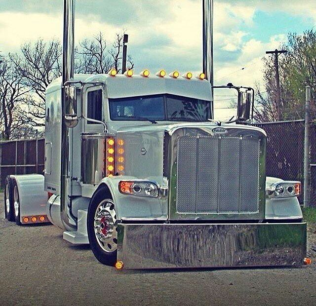 Peterbilt custom 389    Very clean lines and not too many gadgets and by that I mean lights Just enough and that grill is kool too!