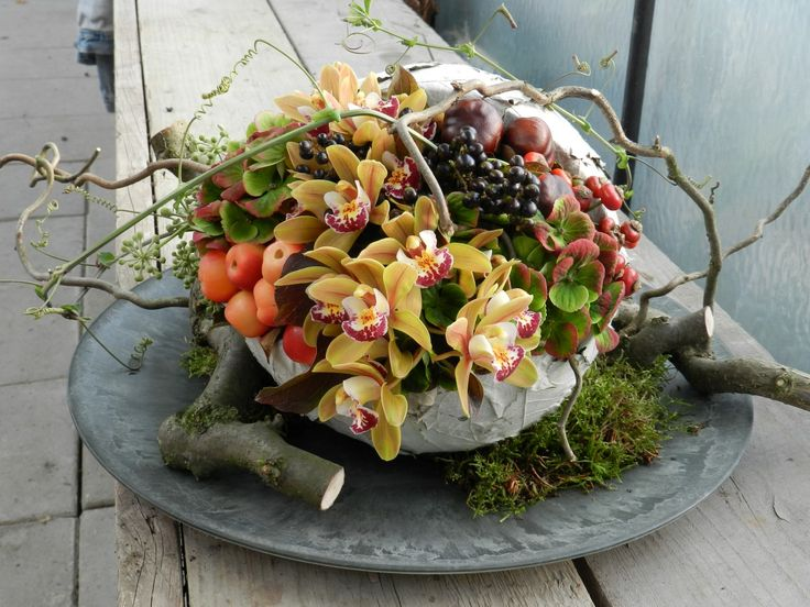 Rustic bowls, moss, twigs and earthy flowers