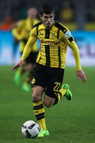 Christian Pulisic of Dortmund runs with the ball during the Bundesliga match between Borussia Dortmund and RB Leipzig at Signal Iduna Park on February 4, 2017 in Dortmund, Germany.