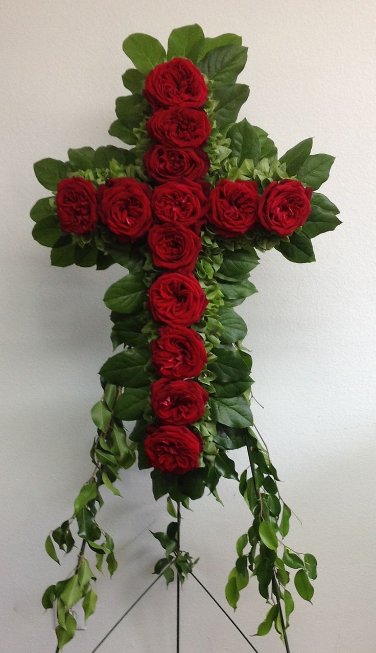 Funeral flower arrangement - red cross