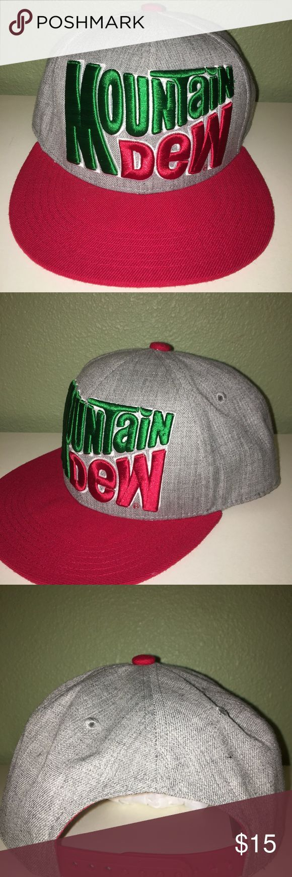 "NWOT MOUNTAIN DEW baseball cap BRAND NEW WITHOUT TAGS MOUNTAIN DEW baseball cap with adjustable back. The cap is gray and the bill all read. It reads (in thick stitching)  ""MOUNTAIN DEW"" in its original and classic form.  THIS HAT HAS NEVER BEEN WORN. MOUNTAIN DEW Accessories Hats"