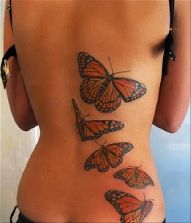 Butterfly watercolor tattoos on lower back for woman. Follow me: forever_wild1 f…