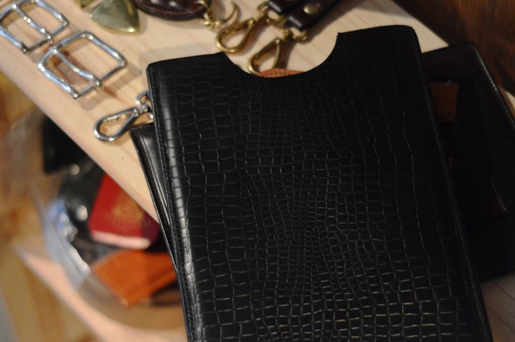 Amidst keyrings and buckles on display in the showroom, here is our 'McAyepad' iPad case, handcrafted from black mock-croc bridle leather. The McAyepad sleeve is practical and sophisticated, and can be personalised with personal initials or a company logo - perfect for business meetings!