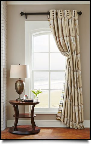 This is a perfect example of an Italian Strung drapery from Rowley Company.  The drape is pulled back using a hidden cord sewn inside the drape.