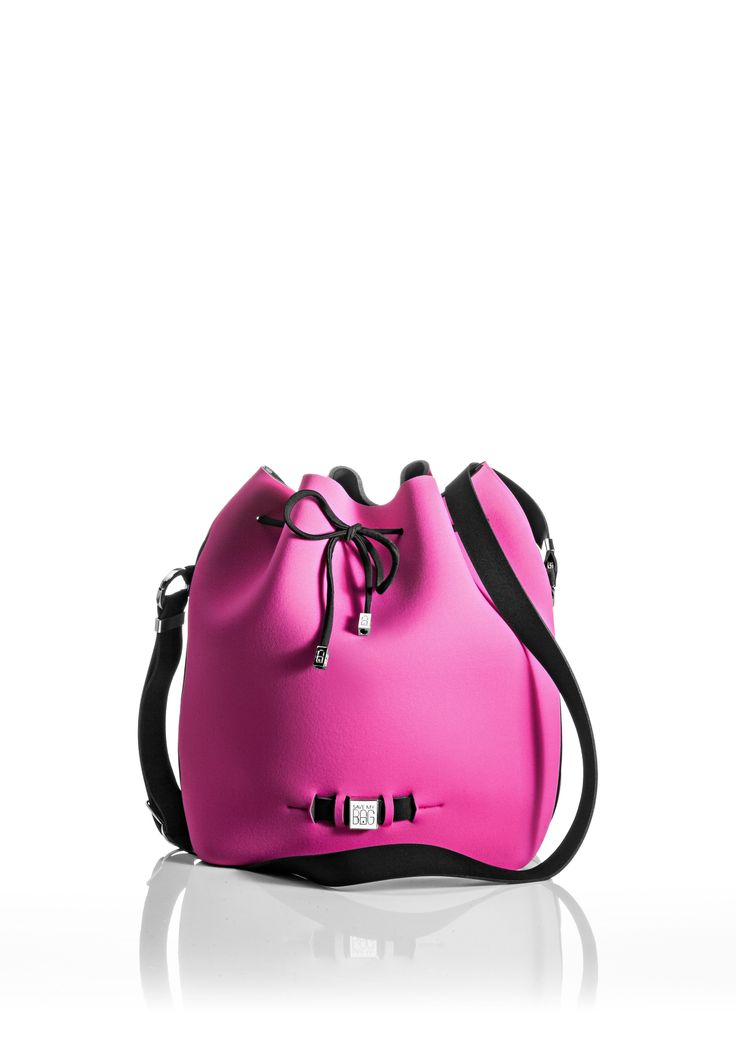 The Bubble is your bucket bag wardrobe staple.  A must-have style alongside totes and cross-bodies for the woman on the go.  With its drawstring closure, side zipper, adjustable strap and spaciousness, this is a practical day-to-day bag or one to take with you on travel adventures!   Size  240 x 175 x 30 mm  320g  Made in Italy  Vegan Friendly  Made from Poly-Lycra Fabric   Hot Pink