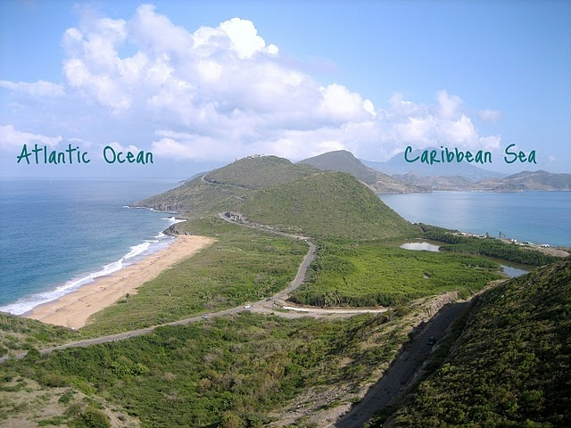 St. Kitts Island.  The west side of the island borders the Caribbean Sea, and the eastern coast faces the Atlantic Ocean.  #TravelBrilliantly