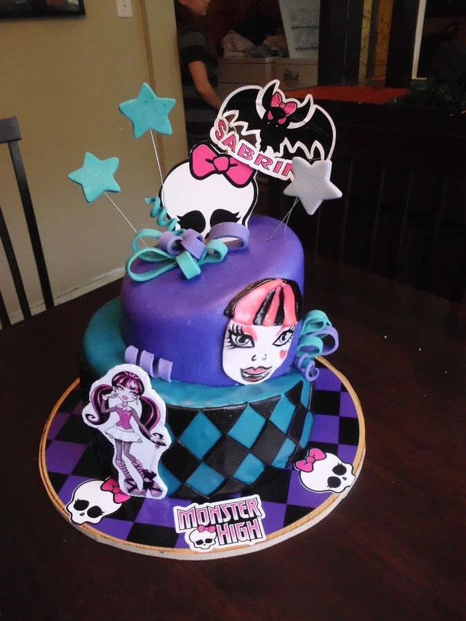 topsy/turvy monster high themed cake. The face is painted on with food coloring
