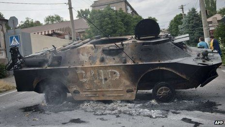 Burned armoured military vehicle belonging to the self-proclaimed Donetsk People's Republic army outside the HQ of the separatist militia, in Mariupol, south-eastern Ukraine, on June 13, 2014