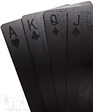 Deck of Black Cards - Each card features glossy, super-intense black ink printed on top of a semi-gloss black coating. This creates a card whose writing and design can shift from intense black to a bright white depending on its angle to light. (Logan)