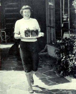 Friends of Betty MacDonald™ - serving iced tea to guests on the patio of her Vashon Island home