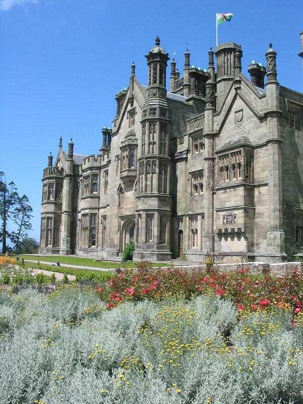 Margam Castle,  Wales is said to be haunted. There are many spirits frequently seen at this Tudor Gothic style mansion, from dark hooded figures to a gamekeeper who worked at the mansion for many years until being murdered by a poacher. His tormented sprit has been seen on many occasions wondering the grounds.
