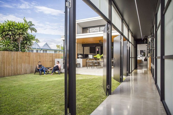 Hallway opening onto central courtyard Laneway house 9point9 architects