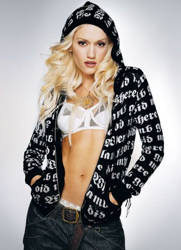 Gwen Stefani. she has one of the best bodies in the music industry coz she works for it..just like everyday,average people.