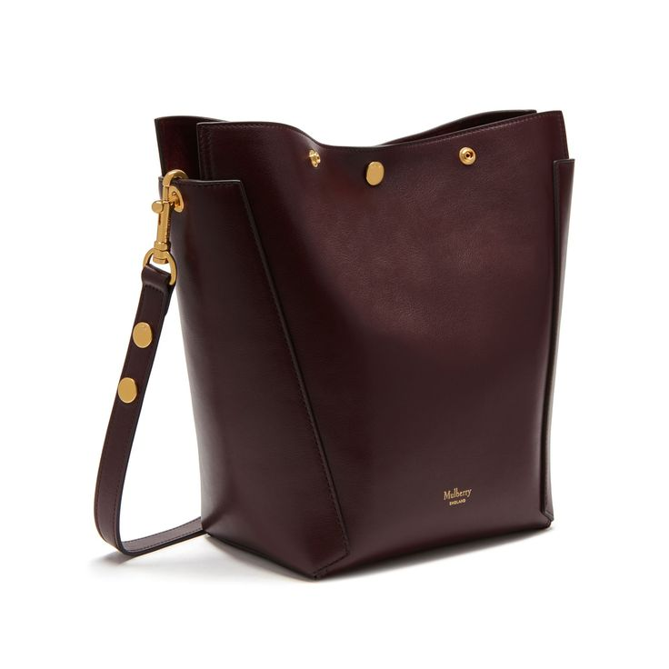 Shop the Small Camden in Oxblood Smooth Calf Leather at Mulberry.com. Introducing the Small Camden. First introduced last season, the Camden has been further refined by Creative Director Johnny Coca to make it the most covetable hobo around. A fully zipped closure keeps everything secure and enhances the smart, understated shape when closed. Finishing details include beautiful suede lining and signature press studs on the shoulder strap.