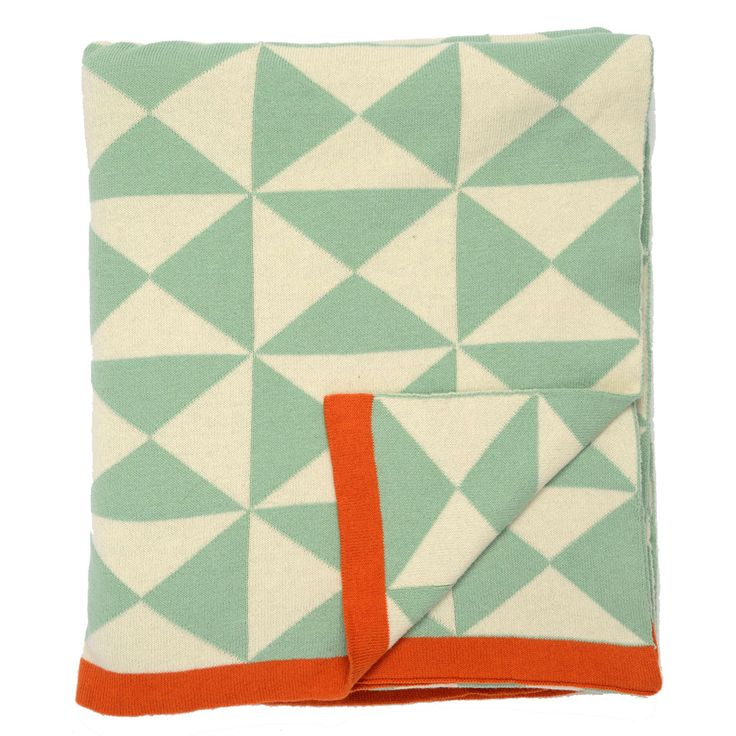 Sea foam and orange throw blanket that is woven from 100% cotton. Modern, chic and cozy!
