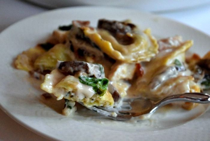 Creamy alfredo sauce, soft pillows of ravioli , spinach and mushrooms - no-one will ever believe it took only 10 minutes to put together!