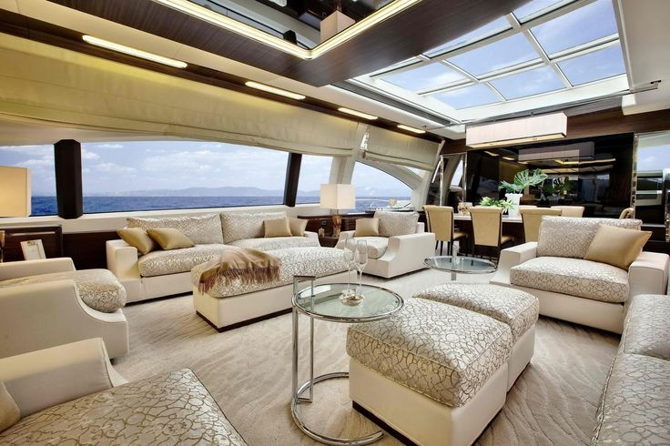 http://www.drissimm.com/wp-content/uploads/2015/04/Luxurious-living-and-dining-room-interior-design-with-high-sky-ceiling-decoration-and-great-view-to-the-ocean.jpg