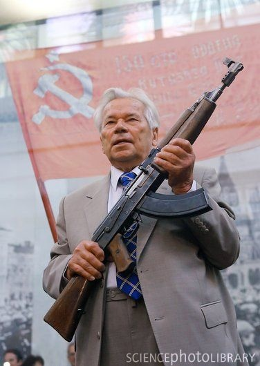 Mikhail Kalashnikov holding the first AK-47