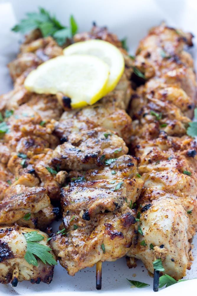 Juicy and super flavorful yogurt marinated chicken kebabs. Grilled for easy weeknight dinner. 180 calories | littlebroken.com @littlebroken. Phase 1 friendly. Notes: use breasts instead of thighs. Use fat free yogurt.