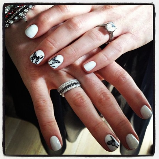 Anne Hathaway's Nail Designs: For the SAG Awards, Anne Hathaway dressed up a white manicure with intricate butterfly designs. The look was a favorite among our Pinterest followers, who swooned over amazing nail art from the red carpet.