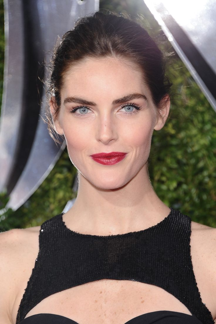 Hilary Rhoda's swept-back updo and a wine-stained lip