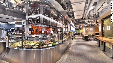 Salad bars and table service? The fast food brand's new concept restaurant is now open in Hong Kong.