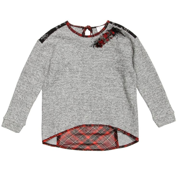 Illudia grey sweater with sparkly silver metallic thread woven throughout. It has a sequin and ribbon brooch on the neckline which can be removed. There is a contrasting black lace panel across the shoulders and a lined red tartan chiffon panel on the back. It is hemmed with tartan chiffon and ties behind the neck in a bow. The back is longer than the front, making these perfect for wearing with leggings. <br /> <ul> <li>73% cotton, 18% acrylic, 4% polyester, 3% visose, 2% ...