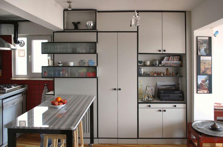 Meydan Architecture Design | Kasımpaşa Studio, Furniture wall and a hidden a storage area behind it