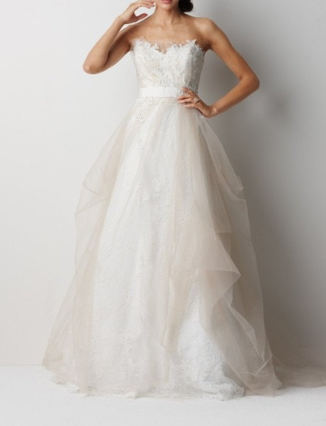 "I usually don't like poofy wedding gowns, but I guess this really doesn't ""poof"" much. Very demure"